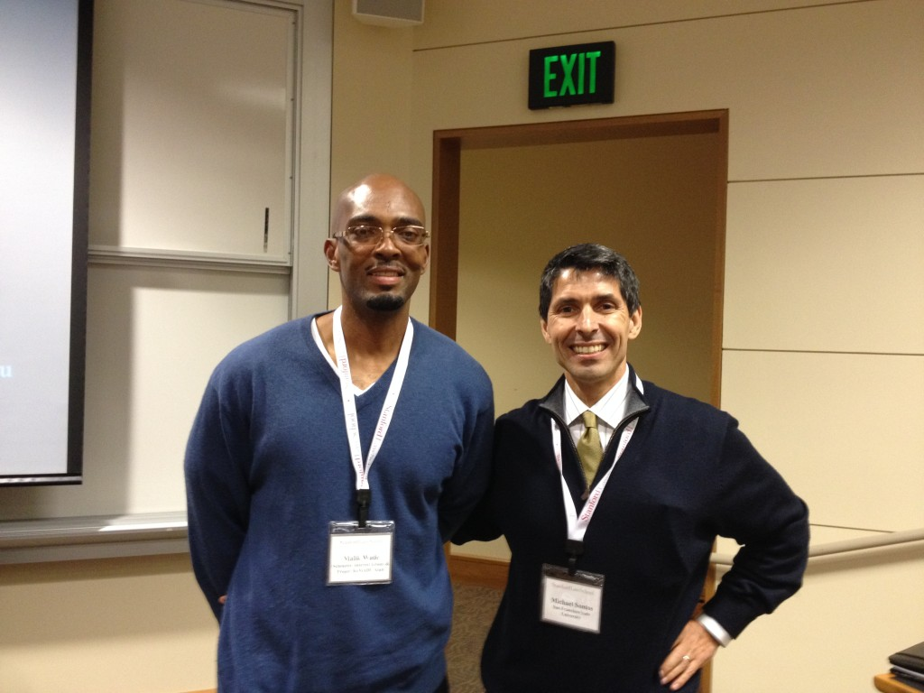 Malik Wade and me standing inside of a classroom at Stanford Law School, getting ready to present