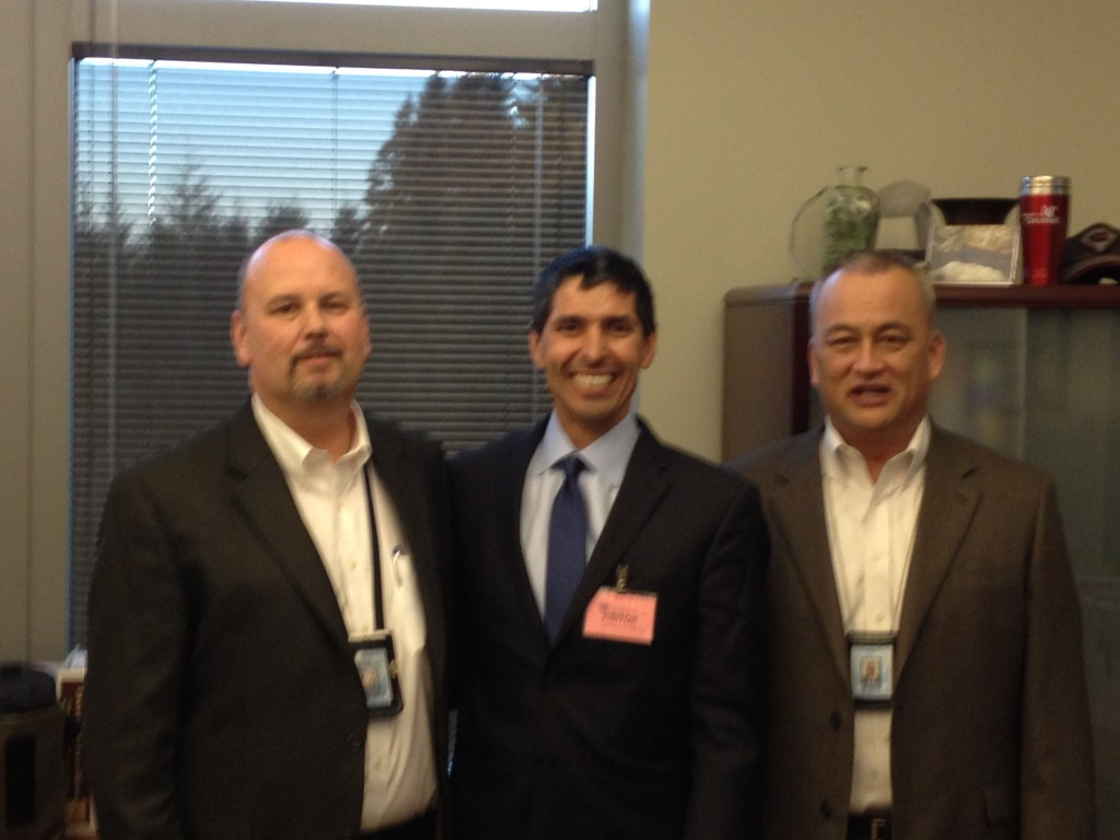 Standing with Dan J. Pacholke and Scott R. Frakes, leaders of the Washington State Prison System