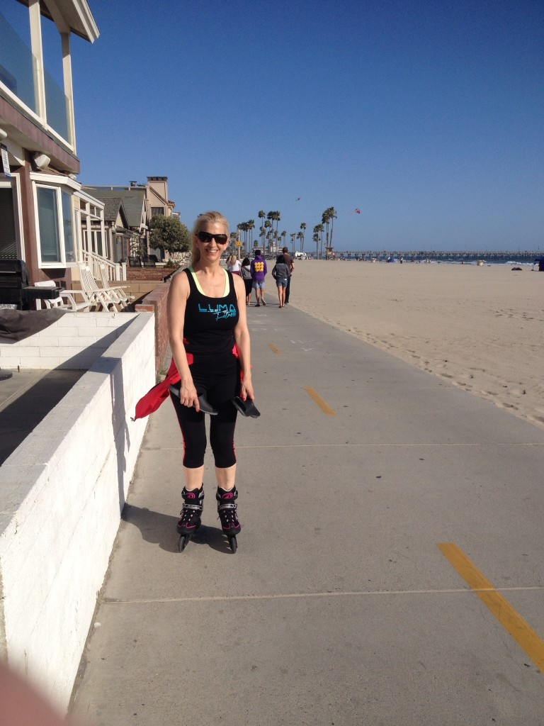 Carole rollerblades beside me while I run on a Newport Beach bike path.